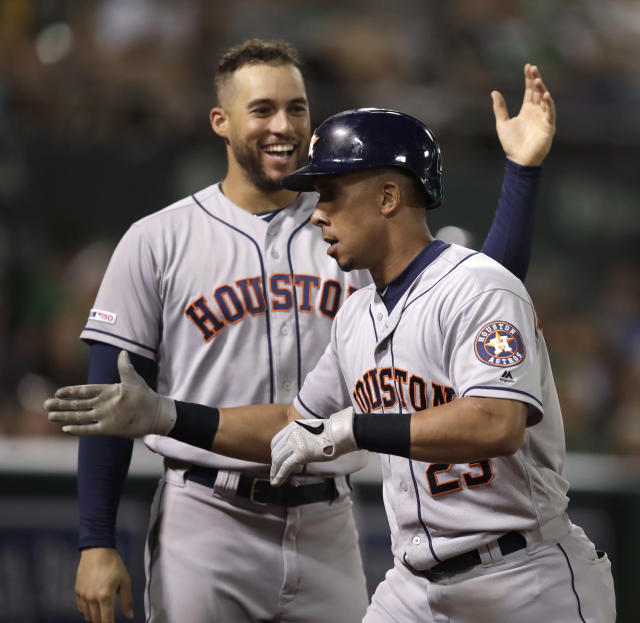 Houston Astros' Michael Brantley, right, is congratulated by George Springer after hitting a home run against the Oakland Athletics during the sixth inning of a baseball game Thursday, Aug. 15, 2019, in Oakland, Calif. (AP Photo/Ben Margot)