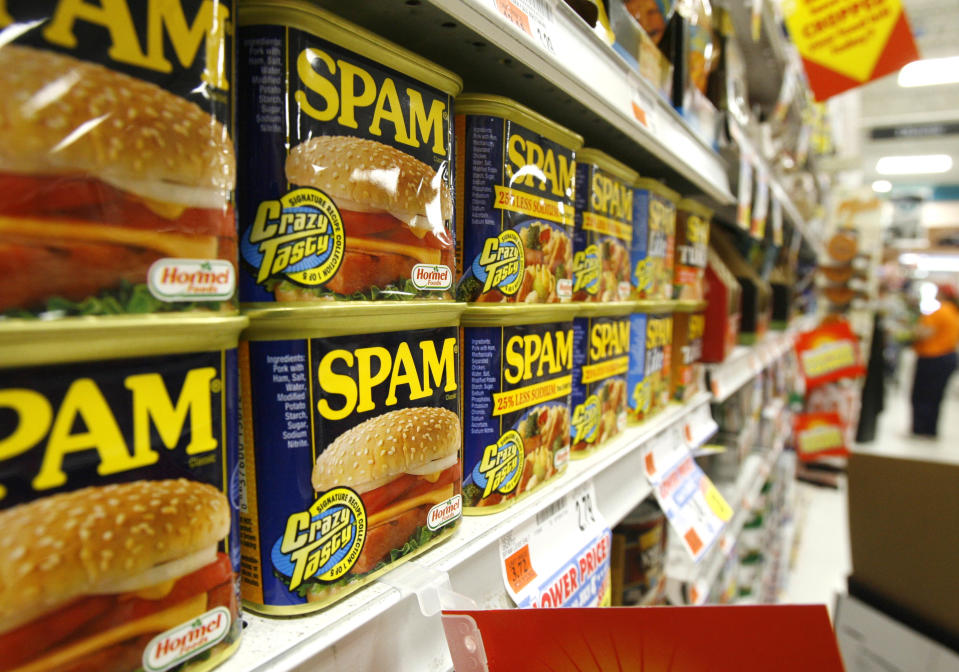 Cans of Spam line the shelves at a store in Berlin, Vt., Tuesday, May 27, 2008. Sales of Spam _ that much maligned meat _ are rising as consumers turning more to lunch meats and other lower-cost foods as a way of stretching they're already stretched food budgets. (AP Photo/Toby Talbot)