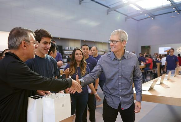 Apple CEO Tim Cook shakes hands with fans at an Apple store the day of the iPhone 8 launch.