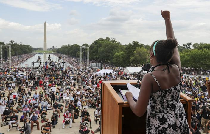 WASHINGTON, DC - AUGUST 28: 12-year-old Yolanda Renee King, the granddaughter of Rev. Martin Luther King Jr., thrusts her fist as she speaks to the