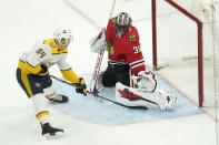 Chicago Blackhawks goaltender Malcolm Subban (30) makes a pad save on a shot by Nashville Predators' Tanner Jeannot during the third period of an NHL hockey game Wednesday, April 21, 2021, in Chicago. (AP Photo/Charles Rex Arbogast)