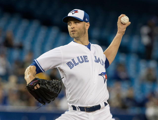 Toronto Blue Jays starting pitcher J.A. Happ throws to a Boston Red Sox batter during the first inning of a baseball game Tuesday, April 24, 2018, in Toronto. (Fred Thornhill/The Canadian Press via AP)