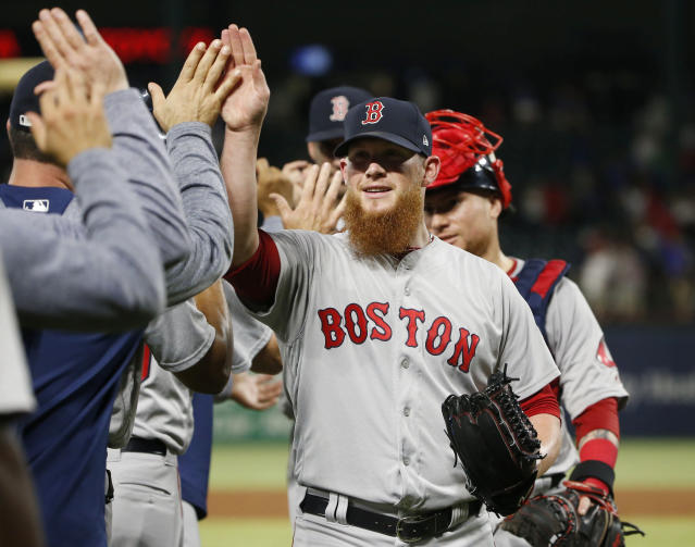 Boston Red Sox relief pitcher Craig Kimbrel is congratulated by teammates after the Red Sox defeated the Texas Rangers 6-5 in a baseball game Saturday, May 5, 2018, in Arlington, Texas. (AP Photo/Michael Ainsworth)