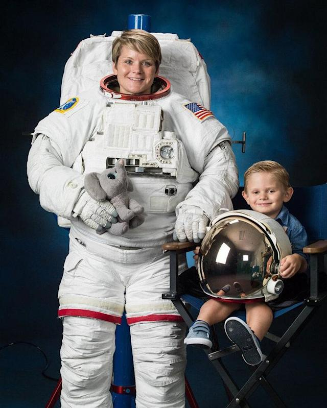 Anne McClain and her 4-year-old son pose together for her official NASA portrait. (Photo: Bill Stafford/NASA)