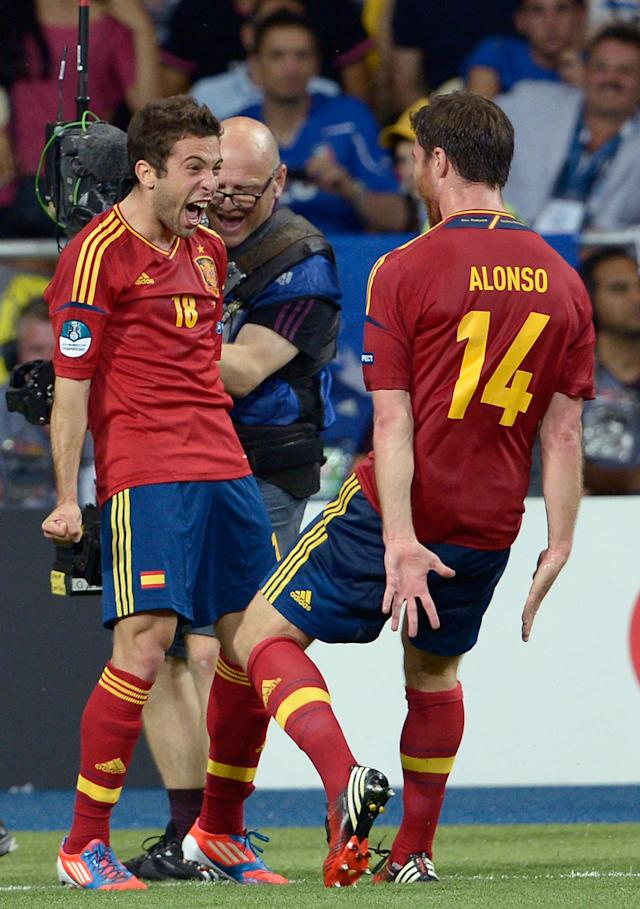 KIEV, UKRAINE - JULY 01: Jordi Alba (L) of Spain celebrates with team-mate Xabi Alonso after scoring their second goal during the UEFA EURO 2012 final match between Spain and Italy at the Olympic Stadium on July 1, 2012 in Kiev, Ukraine. (Photo by Claudio Villa/Getty Images)