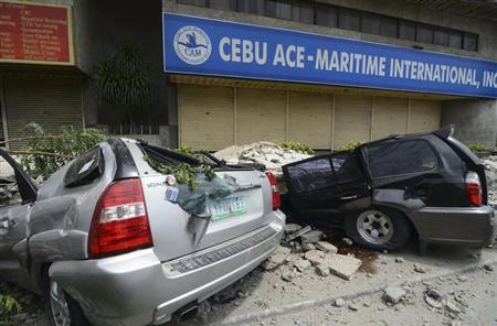 A view of vehicles that were damaged by falling debris after an earthquake struck Cebu city, central Philippines October 15, 2013. REUTERS/STRINGER