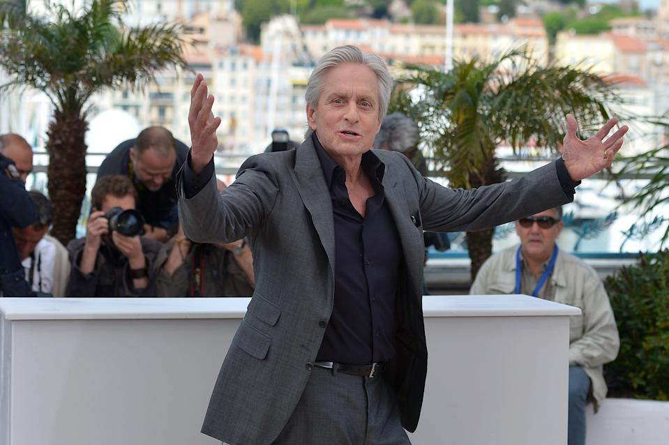 "US actor Michael Douglas poses on May 21, 2013 during a photocall for the film ""Behind the Candelabra"" presented in Competition at the 66th edition of the Cannes Film Festival in Cannes. Cannes, one of the world's top film festivals, opened on May 15 and will climax on May 26 with awards selected by a jury headed this year by Hollywood legend Steven Spielberg.      AFP PHOTO / ALBERTO PIZZOLI        (Photo credit should read ALBERTO PIZZOLI/AFP/Getty Images)"