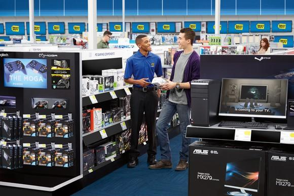 Sales floor of a Best Buy store with a sales rep helping out a customer.