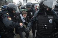 FILE - In this Jan. 23, 2021, file photo, police officers detain a man during a protest against the jailing of opposition leader Alexei Navalny in Moscow, Russia. Allies of Navalny are calling for new protests next weekend to demand his release, following a wave of demonstrations across the country that brought out tens of thousands in a defiant challenge to President Vladimir Putin. (AP Photo/Pavel Golovkin, File)