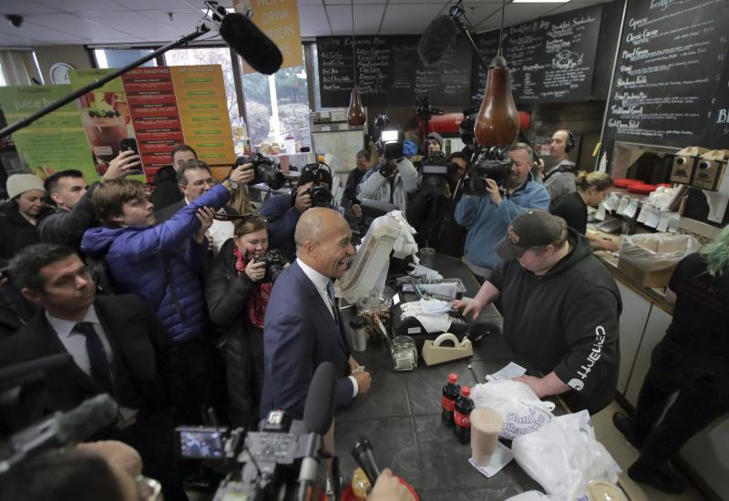 Democratic presidential candidate former Massachusetts Gov. Deval Patrick, center, waits for his food order as he campaigns Thursday, Nov. 14, 2019, at The Bridge Cafe in Manchester, N.H. (AP Photo/Charles Krupa)