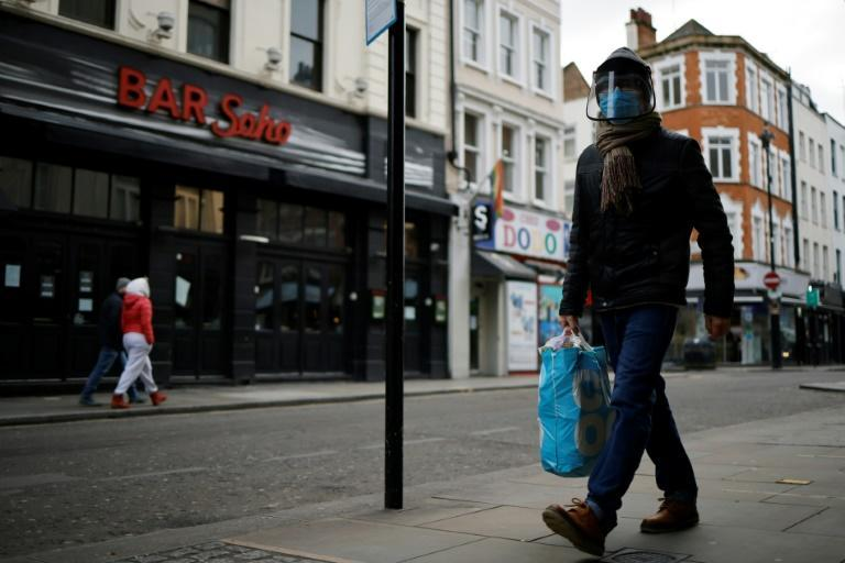 Deserted streets in London due to the coronavirus pandemic testify to the economic damage caused after GDP shrank a record 9.9 percent last year