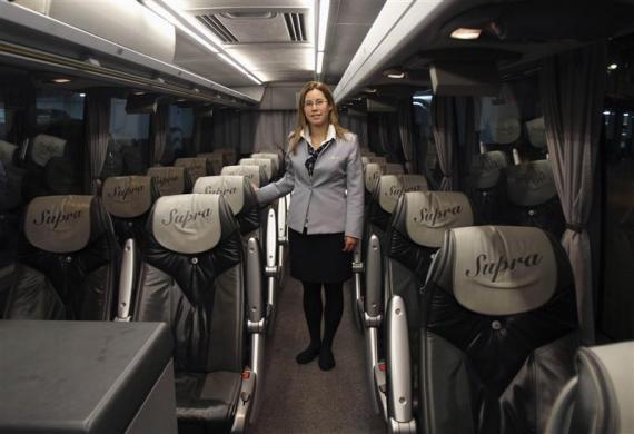Tania Leon, a 29 year-old stewardess, poses inside a bus in Santiago de Compostela, Spain May 9, 2012. Leon studied psychology at the University of Santiago de Compostela and received a degree in 2006. She was hoping to find a job as a psychologist but has been working as a stewardess for the last two years.