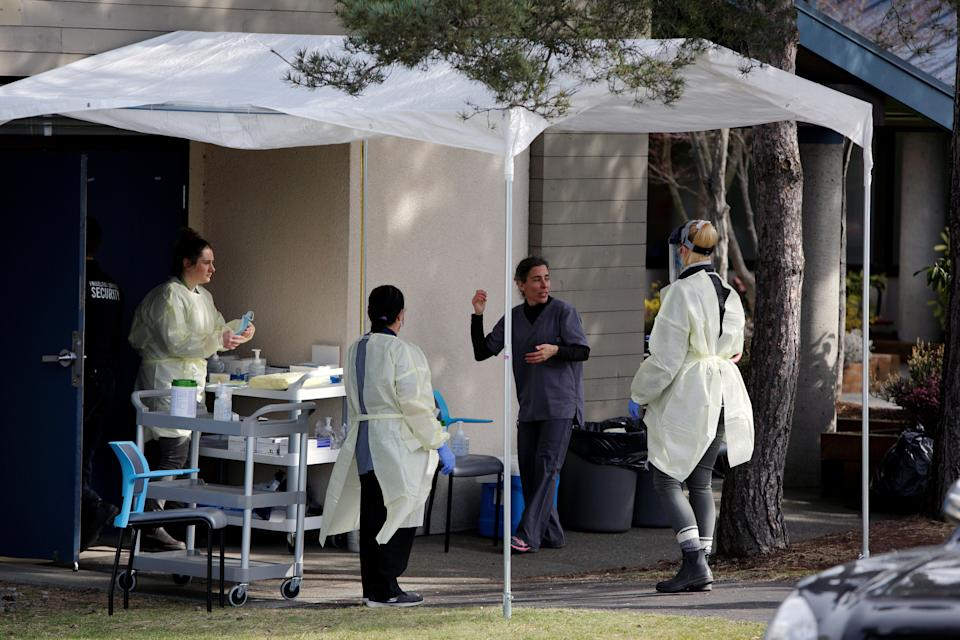 Medical staff prepare for assessing people for novel coronavirus disease at the public Victoria Health Unit in Victoria, B.C. on March 17, 2020. (Photo: Kevin Light / Reuters)