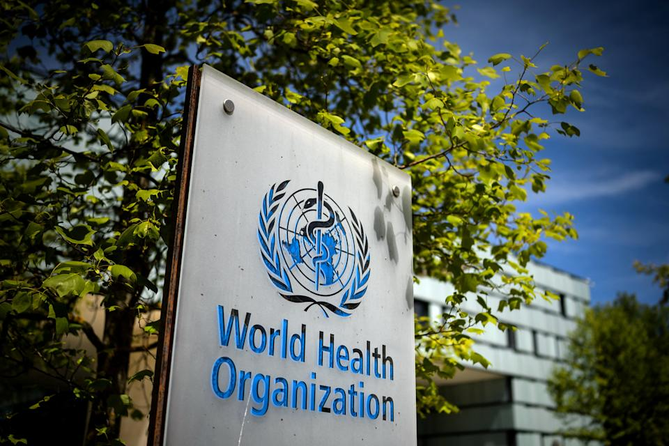 A picture taken on May 8, 2021 shows a sign of the World Health Organization (WHO) at the entrance of their headquarters in Geneva amid the Covid-19 coronavirus outbreak. (Photo by Fabrice COFFRINI / AFP) (Photo by FABRICE COFFRINI/AFP via Getty Images)