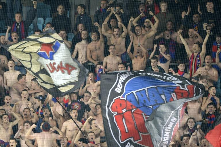 CSKA Moscow's fans support their team during the UEFA Champions League group B football match between CSKA Moscow and PSV Eindhoven at the Khimki Arena outside Moscow on September 30, 2015