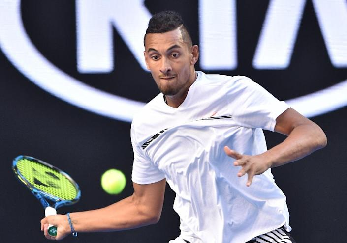 Australia's Nick Kyrgios hits a return against Italy's Andreas Seppi during their Australian Open second round match, in Melbourne, on January 18, 2017 (AFP Photo/PETER PARKS)