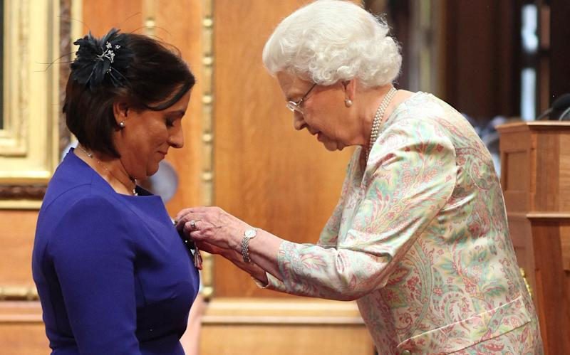 Detective Constable Nighat Hubbard was presented with an MBE by the Queen in 2014 - PA Archive/PA Images