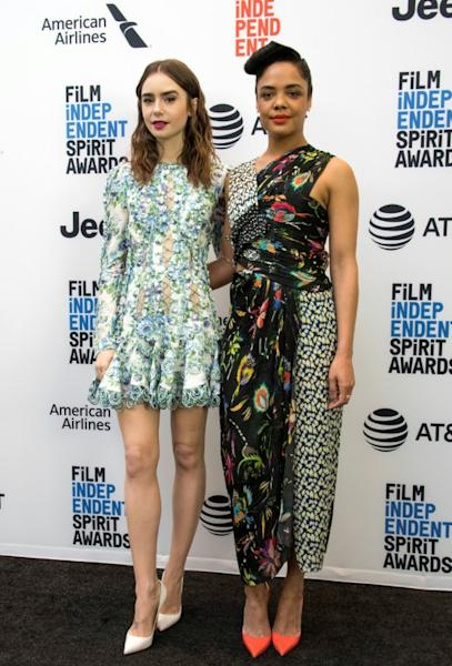 Actresses Lily Collins (L) and Tessa Thompson unveiled the Spirit Award nominations in West Hollywood