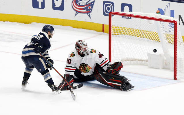 Chicago Blackhawks goalie Robin Lehner, right, of Sweden, stops a shot by Columbus Blue Jackets forward Nathan Gerbe during an overtime period of an NHL hockey game in Columbus, Ohio, Sunday, Dec. 29, 2019. (AP Photo/Paul Vernon)