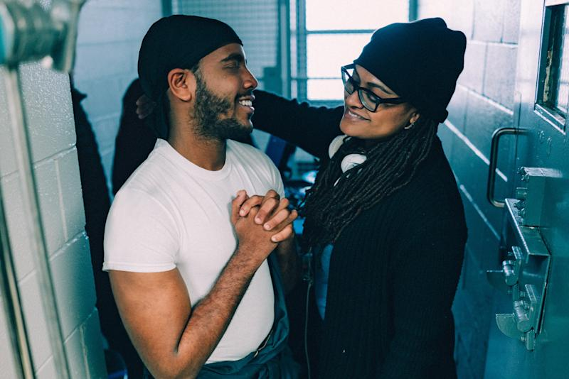 "DuVernay (pictured here with Jharrel Jerome) changed the working title of the series from Central Park Five in order to ""redefine the scope of the story."""