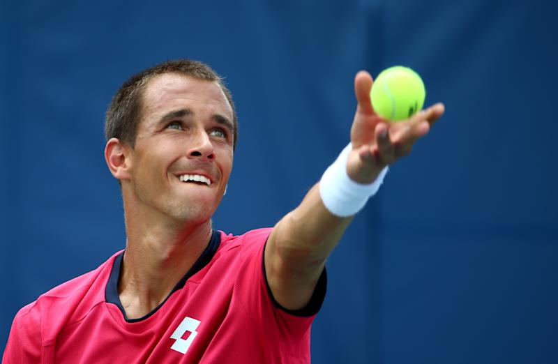 Lukas Rosol of the Czech Republic serves to Jerzy Janowicz of Poland during the men's finals match of the Winston-Salem Open on August 23, 2014
