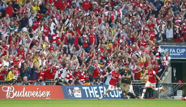 Arsenal's Aaron Ramsey (L) celebrates with team mate Kieran Gibbs after scoring his team's third goal during their FA Cup final soccer match against Hull City at Wembley Stadium in London, May 17, 2014. REUTERS/Eddie Keogh (BRITAIN - Tags: SPORT SOCCER)