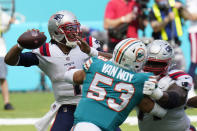 New England Patriots quarterback Cam Newton (1) looks to pass the football during the first half of an NFL football game against the Miami Dolphins, Sunday, Dec. 20, 2020, in Miami Gardens, Fla. (AP Photo/Chris O'Meara)