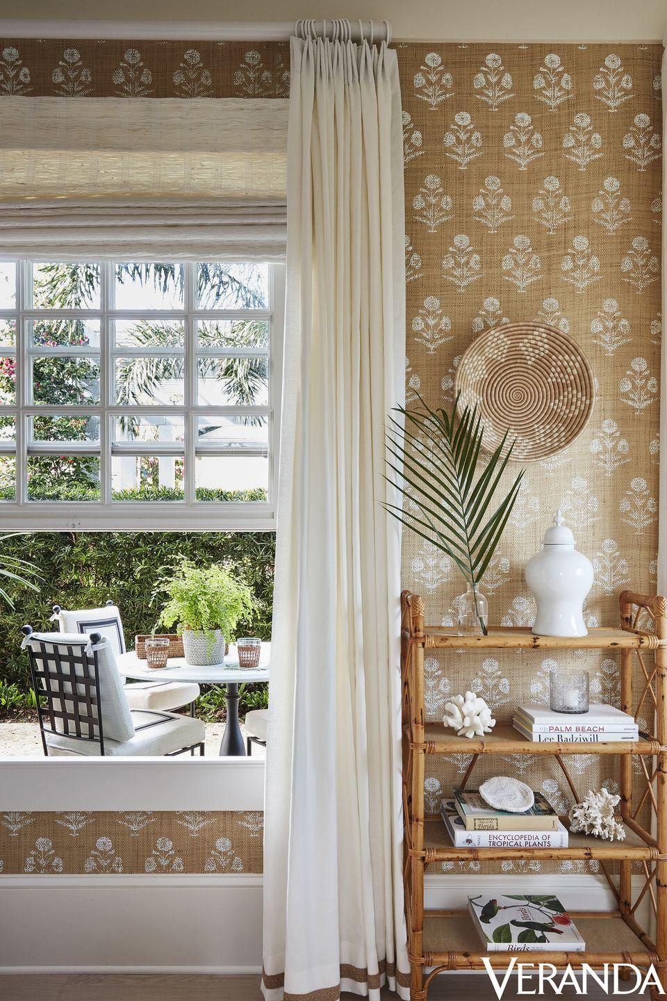 """<p>This breezy, beautiful vignette can be found in a <a href=""""https://www.veranda.com/decorating-ideas/a19833976/alessandra-branca-windsor-florida-village-suites/"""" rel=""""nofollow noopener"""" target=""""_blank"""" data-ylk=""""slk:Windsor, Florida home"""" class=""""link rapid-noclick-resp"""">Windsor, Florida home</a> designed by Alessandra Branca. The designer used a stunning grasscloth wallpaper from her own line to bring texture and a global-meets-coastal feel to the space. </p>"""