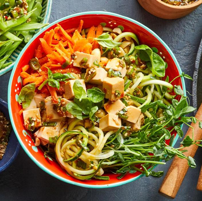 <p>This fast vegan version of poke (the traditional Hawaiian salad of diced raw fish tossed in a soy-sesame sauce) swaps in extra-firm tofu for fish while loading your bowl with vegetables and crunchy toppers like pea shoots and peanuts. Serve over brown rice instead of the zucchini noodles to add a hearty boost of fiber.</p>