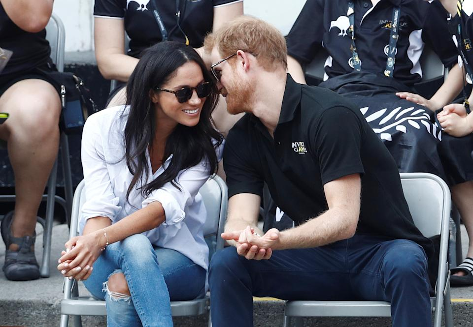 Britain's Prince Harry and his girlfriend actress Meghan Markle watch the wheelchair tennis event during the Invictus Games in Toronto, Ontario, Canada September 25, 2017.   REUTERS/Mark Blinch