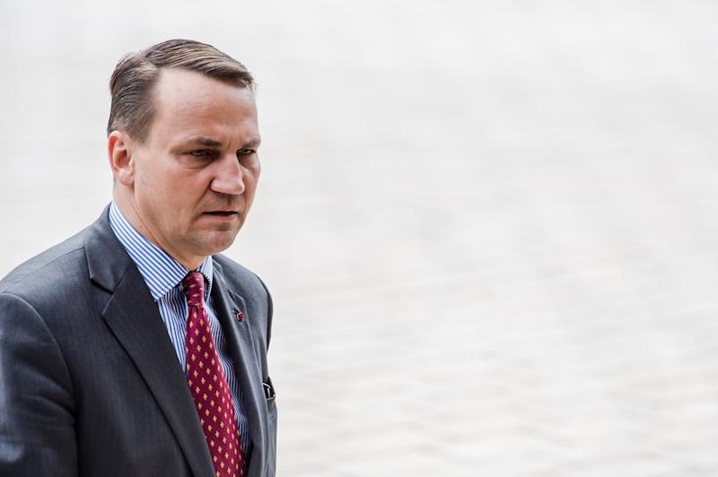 Poland's Foreign Minister Radoslaw Sikorski arrives for an EU foreign ministers meeting at the EU Council building in Luxembourg, Monday, April 14, 2014. EU foreign ministers meet Monday to discuss the crisis in Syria and Ukraine and hold an in-depth exchange on Bosnia and Herzegovina. (AP Photo/Geert Vanden Wijngaert)