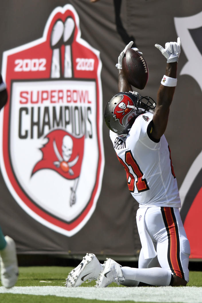 Tampa Bay Buccaneers wide receiver Antonio Brown (81) celebrates his 62-yard touchdown reception during the first half of an NFL football game against the Miami Dolphins Sunday, Oct. 10, 2021, in Tampa, Fla. (AP Photo/Jason Behnken)