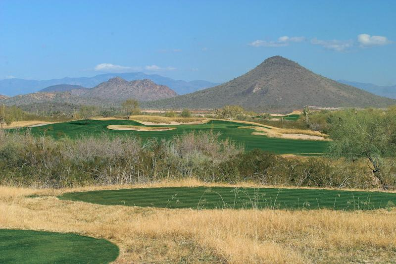 This undated photo courtesy of Trilogy Golf Club at Vistancia shows a portion of their course in Peoria, Ariz. A little different than the cactus-and-desert courses around the area; the tall fescue grass off the fairways and multiple bunkering at Trilogy is more like something you'd find in Nebraska or Iowa.   (AP Photo/Trilogy Golf Club at Vistancia)