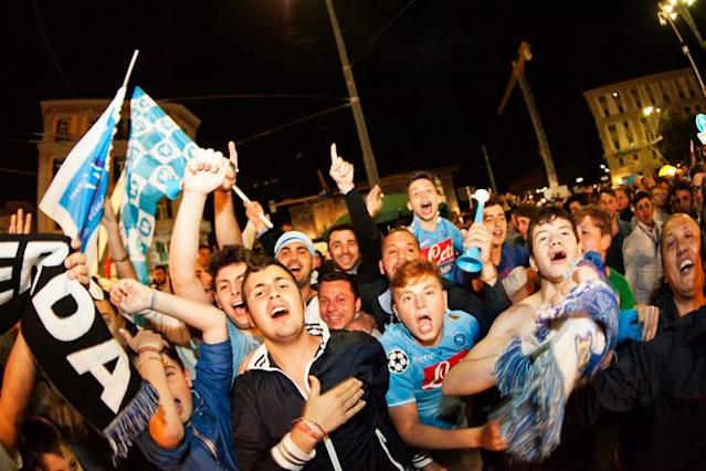 Napoli's football fans celebrate the victory of their team in Naples on May 21, 2012. S.S.C. Juventus' record-breaking 43-match undefeated run came to an end when Napoli won the Italian Cup 2-0. AFP PHOTO/ ANDREA BALDOANDREA BALDO/AFP/GettyImages