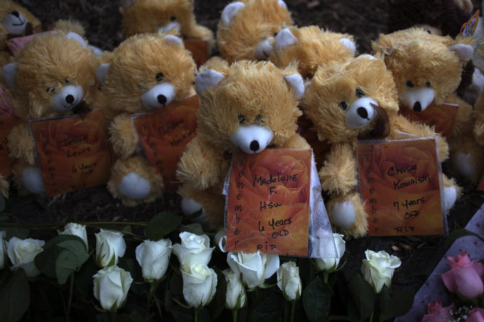 The names of victims from the Sandy Hook shooting are attached to teddy bears, part of a memorial in Sandy Hook Village two days after the shooting. (Photo: Adrees Latif/Reuters)
