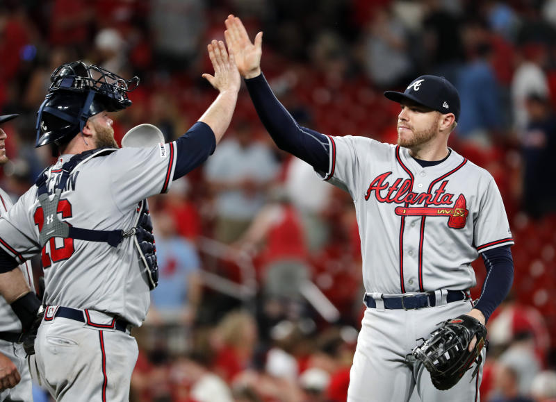 Atlanta Braves' Freddie Freeman, right, and Brian McCann celebrate a 4-3 victory over the St. Louis Cardinals in a baseball game, Sunday, May 26, 2019, in St. Louis. (AP Photo/Jeff Roberson)