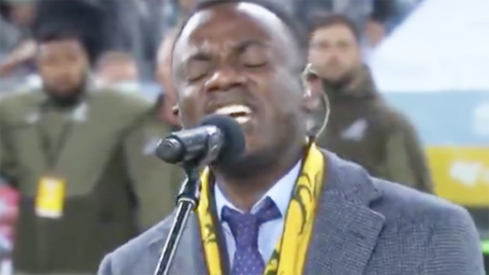 David Nduwimana is pictured singing the Australian national anthem.