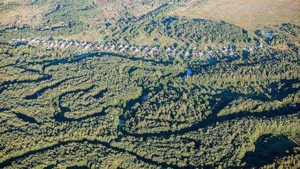 PHOTO: In this July 31, 2018, file photo, an aerial view of houses in a forest near the village of Merinovo is shown in the Nizhny Novgorod region of Russia. (Mikhail Solunin/TASS via Getty Images, FILE)