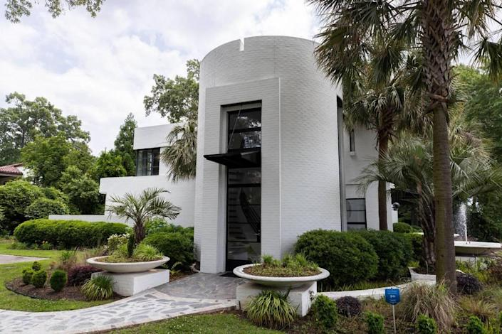This distinctive home across from St. Joseph Church was designed by architect Beau Clowney. Owner Kevin Fisher worked with an art director to design the primary color rich interior.