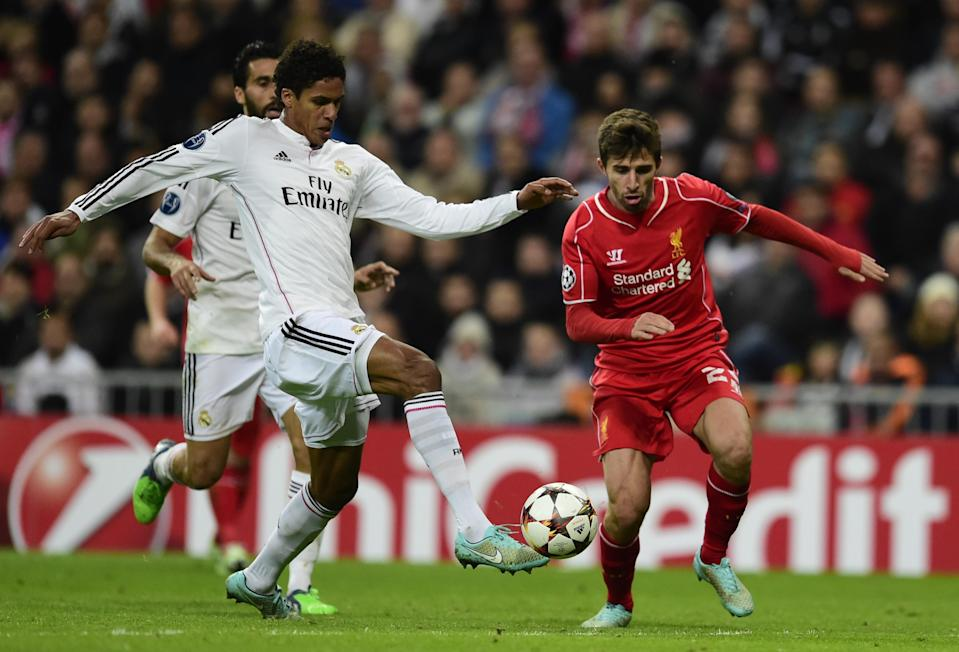 Liverpool's Fabio Borini (R) and Real Madrid's Raphael Varane during their Champions League in Madrid on November 4, 2014 (AFP Photo/Javier Soriano)