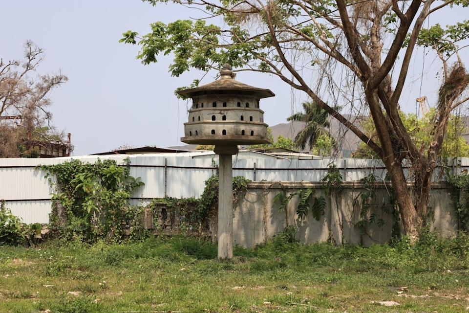 A house for pigeons stands atop a stone pillar outside the Hakka mansion built in 1936. Photo: K. Y. Cheng