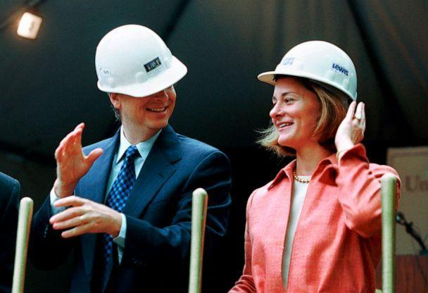 PHOTO: In this file photo taken on May 4, 2001, Microsoft chairman Bill Gates contends with an ill-fitting hard hat while his wife, Melinda Gates, looks on at a groundbreaking ceremony in Seattle. (Andy Rogers/AP, File)
