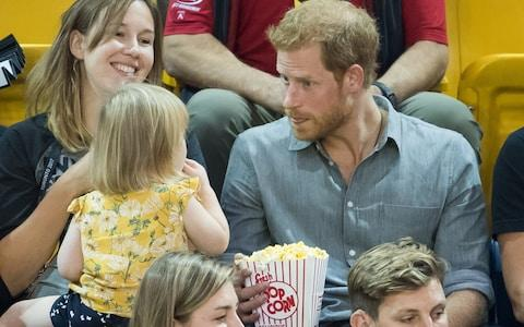 TORONTO, ON - SEPTEMBER 27: Prince Harry (R) sits with David Henson's wife Hayley Henson (L) and daugther Emily Henson at the Sitting Volleyball Finals on day 5 of the Invictus Games Toronto 2017  - Credit: Samir Hussein/WireImage
