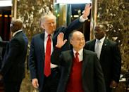 U.S. President-elect Donald Trump and Softbank CEO Masayoshi Son acknowledge guests after meeting at Trump Tower in Manhattan, New York City, U.S., December 6, 2016. REUTERS/Brendan McDermid