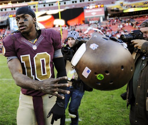 Washington Redskins quarterback Robert Griffin III (10) tosses his helmet after an NFL football game against the Carolina Panthers, Sunday, Nov. 4, 2012, in Landover, Md. The Panthers won 21-13. (AP Photo/Nick Wass)