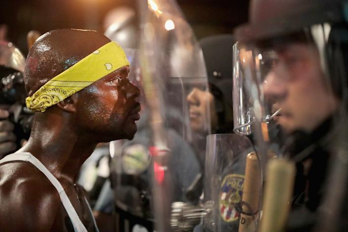Protesters and police officers in St. Louis, Missouri stare each other down on September 16, 2017. (Getty Images)