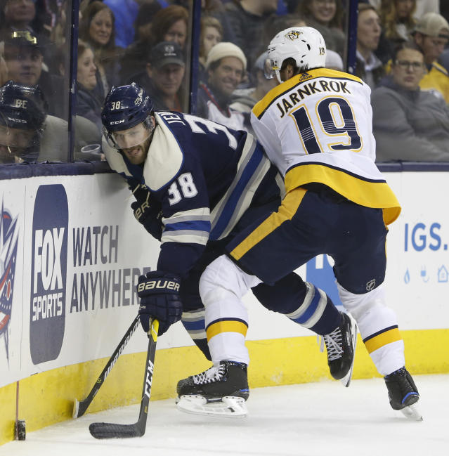 Nashville Predators' Calle Jarnkrok, right, of Sweden, checks Columbus Blue Jackets' Boone Jenner during the second period of an NHL hockey game Thursday, Jan. 10, 2019, in Columbus, Ohio. (AP Photo/Jay LaPrete)