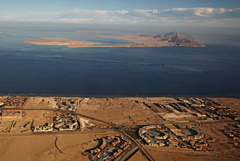 (FILES) This file photo taken on January 14, 2014, through the window of an airplane shows the Red Sea's Tiran (foreground) and the Sanafir (background) islands in the Strait of Tiran between Egypt's Sinai Peninsula and Saudi Arabia