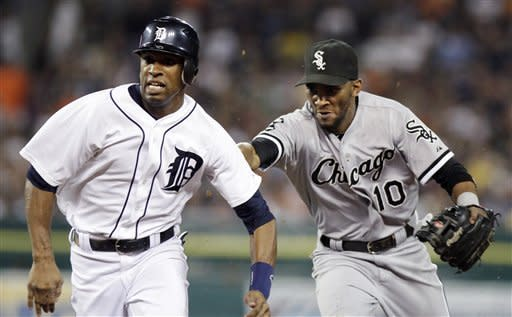 Chicago White Sox shortstop Alexei Ramirez (10) reaches out to tag out Detroit Tigers' Austin Jackson after getting caught in a rundown between first and second base in the fifth inning of a baseball game, Sunday, Sept. 2, 2012, in Detroit. (AP Photo/Duane Burleson)