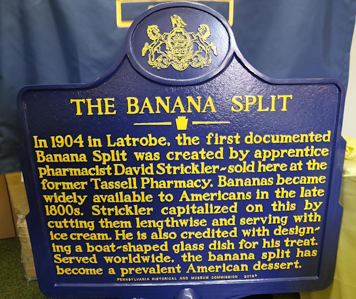 The Pennsylvania Historical and Museum Commission marker for the banana split is displayed at the municipal offices in Latrobe, Pa., Wednesday Aug. 21, 2013. A weekend of festivities are planned to surround the dedication of the marker that acknowledges apprentice pharmacist David E. Strickler for inventing the banana split there in 1904. (AP Photo/Keith Srakocic)